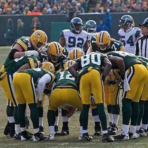Green Bay Packers team in a huddle
